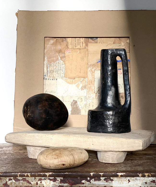 black terracotta pot with handle