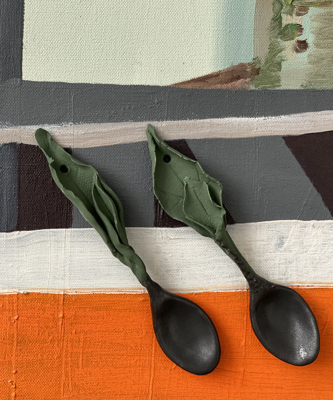 small glossy black leaf spoon